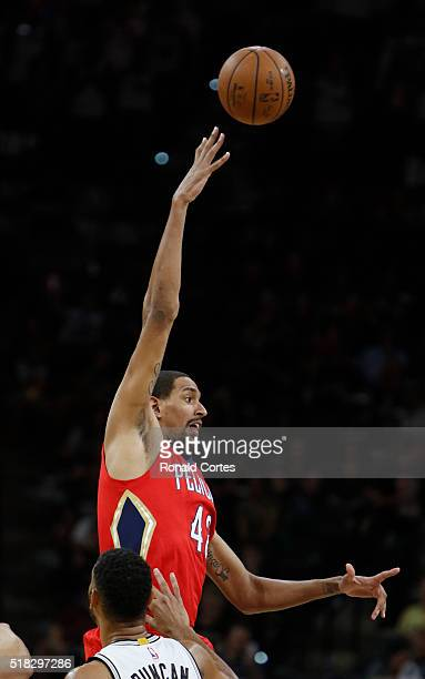 Alexis Ajinca of the New Orleans Pelicans out jumps Tim Duncan of the San Antonio Spurs at ATT Center on March 30 2016 in San Antonio Texas NOTE TO...