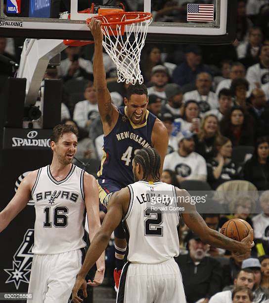 Alexis Ajinca of the New Orleans Pelicans reacts after a dunk against Pau Gasol of the San Antonio Spurs and Kawhi Leonard of the San Antonio Spurs...