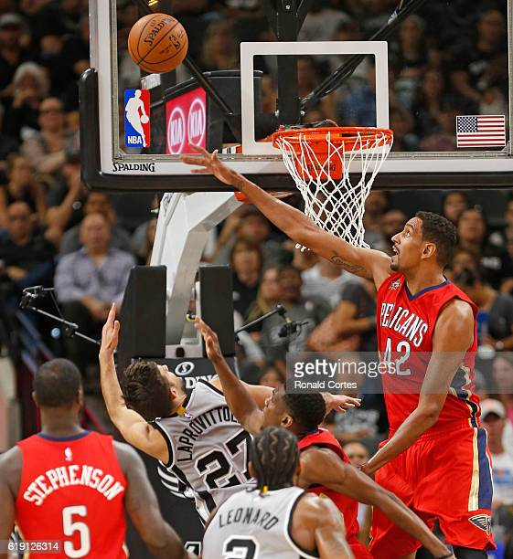 Alexis Ajinca of the New Orleans Pelicans rejects who attempt of Nicolas Laprovittola of the San Antonio Spurs during game between New Orleans...