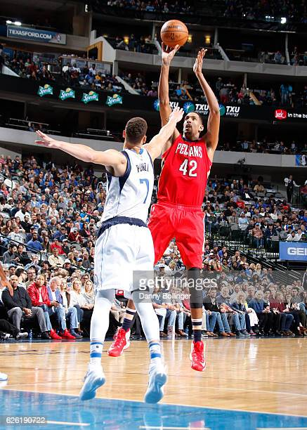 Alexis Ajinca of the New Orleans Pelicans shoots a jumper against Dwight Powell of the Dallas Mavericks on November 27 2016 at the American Airlines...