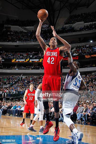 Alexis Ajinca of the New Orleans Pelicans shoots a jumper against the Dallas Mavericks on March 2, 2015 at the American Airlines Center in Dallas,...