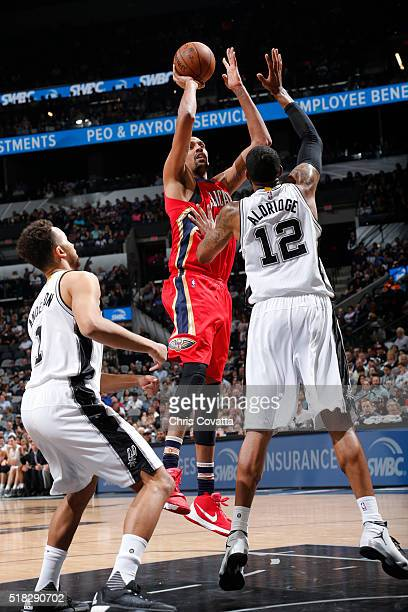 Alexis Ajinca of the New Orleans Pelicans shoots against LaMarcus Aldridge of the San Antonio Spurs during the game on March 30 2016 at ATT Center in...