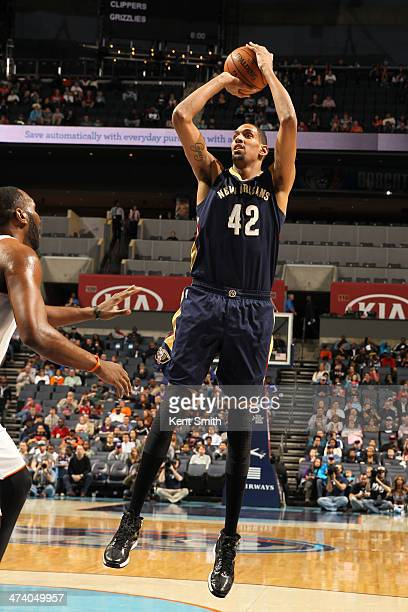 Alexis Ajinca of the New Orleans Pelicans shoots against the Charlotte Bobcats during the game at the Time Warner Cable Arena on February 21 2014 in...