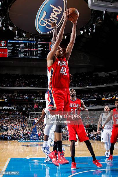 Alexis Ajinca of the New Orleans Pelicans shoots against the Dallas Mavericks on March 2, 2015 at the American Airlines Center in Dallas, Texas. NOTE...