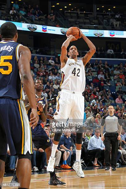 Alexis Ajinca of the New Orleans Pelicans shoots against the Utah Jazz on March 28 2014 at the Smoothie King Center in New Orleans Louisiana NOTE TO...