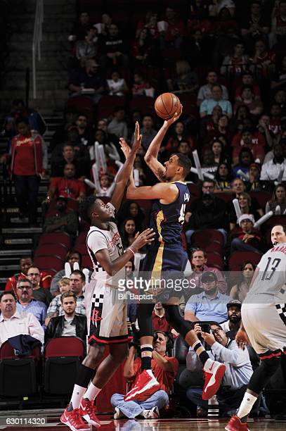 Alexis Ajinca of the New Orleans Pelicans shoots the ball against Clint Capela of the Houston Rockets during the game on December 16 2016 at the...