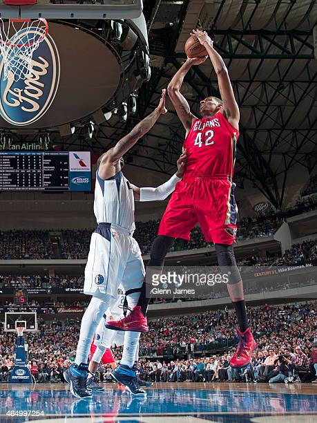 Alexis Ajinca of the New Orleans Pelicans shoots the ball against the Dallas Mavericks during the game on March 2, 2015 at the American Airlines...