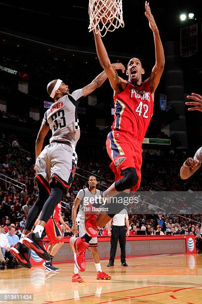 Alexis Ajinca of the New Orleans Pelicans shoots the ball against the Houston Rockets on March 2 2016 at the Toyota Center in Houston Texas NOTE TO...
