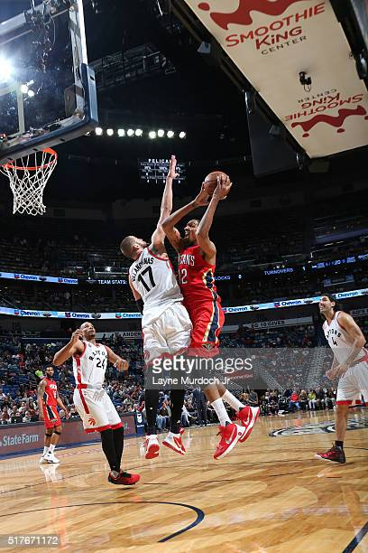 Alexis Ajinca of the New Orleans Pelicans shoots the ball against the Toronto Raptors on March 26 2016 at Smoothie King Center in New Orleans...