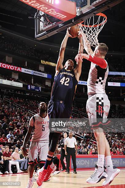 Alexis Ajinca of the New Orleans Pelicans shoots the ball against the Houston Rockets during the game on December 16 2016 at the Toyota Center in...