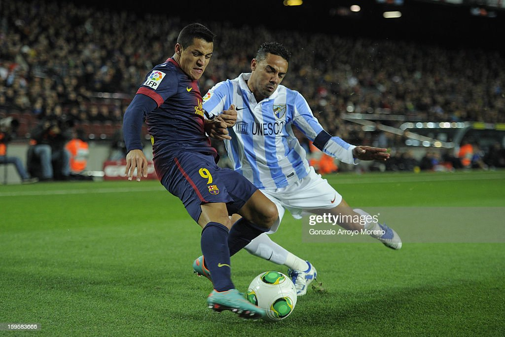 Alexis Alejandro Sanchez of Barcelona FC competes for the ball with Weligton Robson of Malaga CF during the Copa del Rey Quarter Final match between Barcelona FC and Malaga CF at Camp Nou on January 16, 2013 in Barcelona, Spain.