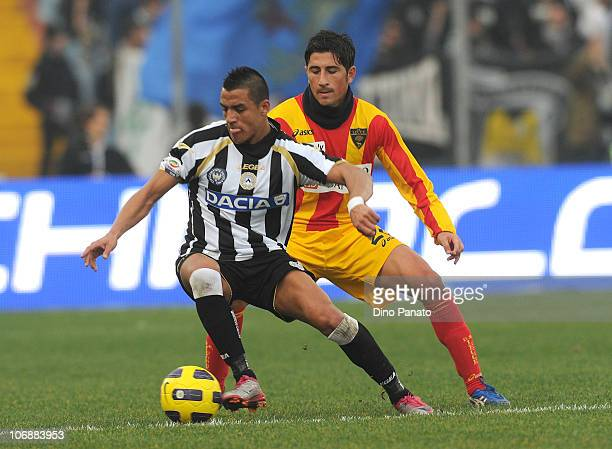Alexis Alejandro Sanchez of Udinese shields the ball from Giuseppe Vives of Lecce during the Serie A match between Udinese and Lecce at Stadio Friuli...