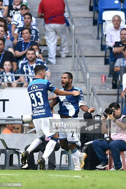 Alexis Angulo of Puebla celebrates with teammate Néstor Vidrio #33 after scoring his team's second goal during the 10th round match between Monterrey...