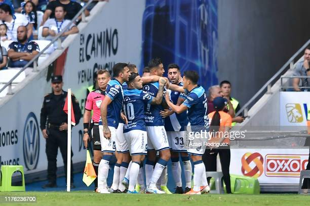 Alexis Angulo of Puebla celebrates with teammates after scoring his team's second goal during the 10th round match between Monterrey and Puebla as...