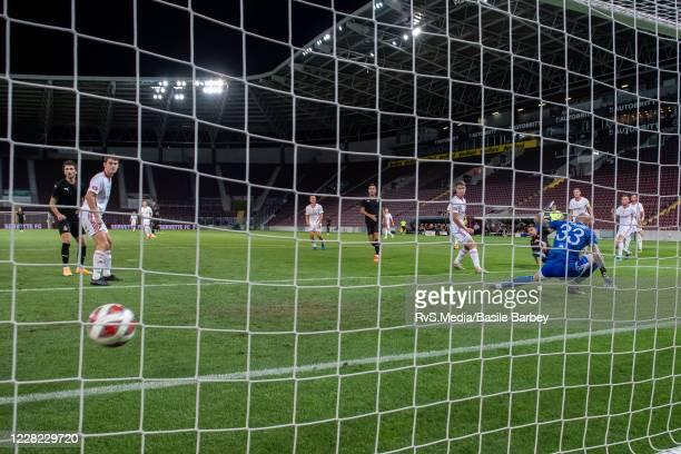 Alexis Antunes of Servette FC scores a goal against Goalkeeper Matus Macik of MFK Ruzomberok during the UEFA Europa League qualification match...