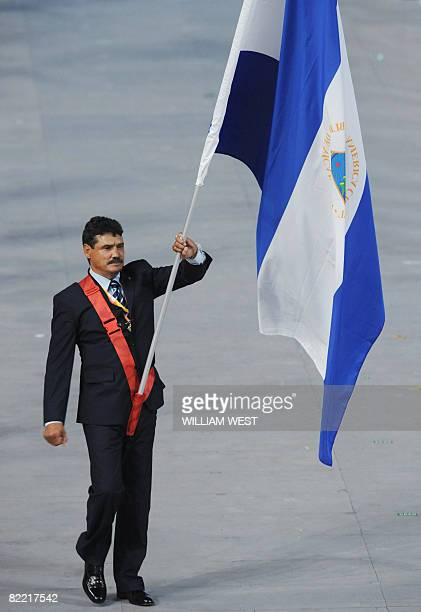 Alexis Arguello Nicaragua's flag bearer parades in front of his delegation during the 2008 Beijing Olympic Games opening ceremony on August 8 2008 at...