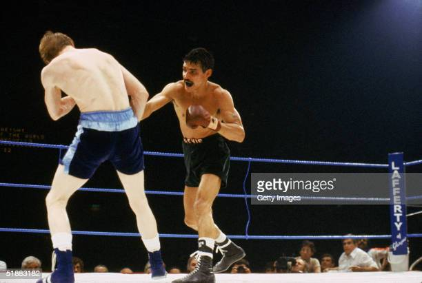 Alexis Arguello of Nicaragua takes on Jim Watt of Great Britain during the WBC Lightweight Championship bout on June 20 1981 in London England...