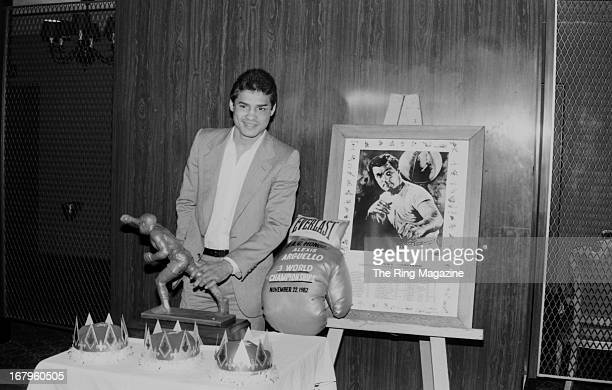 Alexis Arguello poses as he receives an award for being 3 time world champion