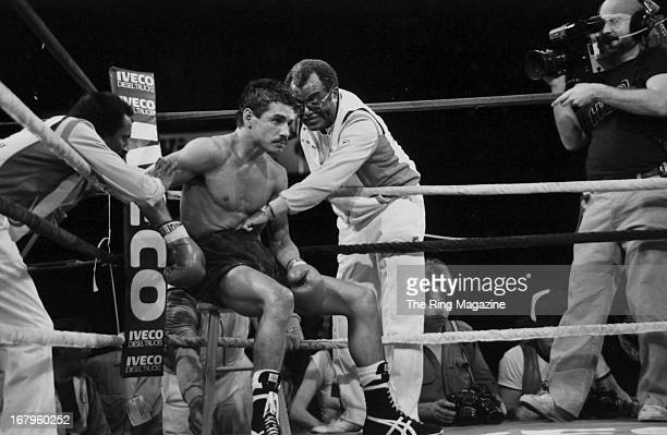 Alexis Arguello rests in his corner during the fight against Aaron Pryor during the bout at the Orange Bowl on November 12 1982 in Miami Florida...