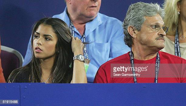 Alexis Barbara girlfriend of Mark Philippoussis watches on with Nick Philippoussis during the game between Mark Philippoussis of Australia and Peter...