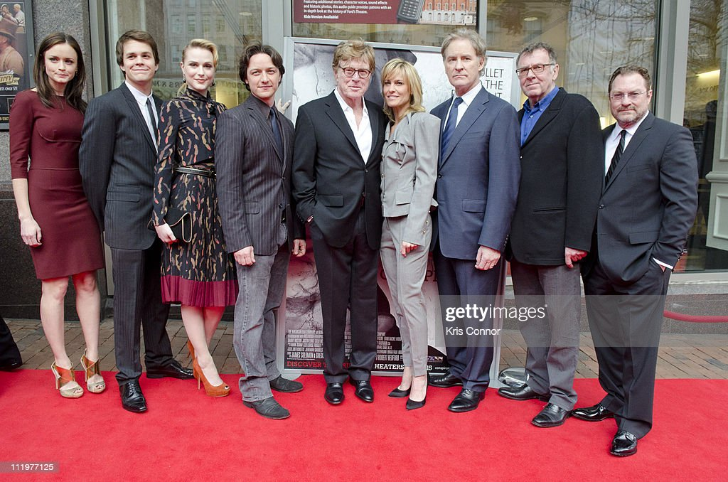 Alexis Bledel, Johnny Simmons, Evan Rachel Wood, James McAvoy, Robert Redford, Robin Wright, Kevin Kline, Tom Wilkinson and Stephen Root pose for photos on the red carpet during the premiere of 'The Conspirator' presented by The American Film Company, Ford's Theatre and Roadside Attractions at Ford's Theatre on April 10, 2011 in Washington, DC.
