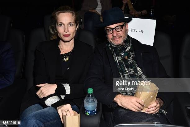 Alexis Bloom and Fisher Stevens attend The Cinema Society Avion host a screening of DreamWorks and Universal Pictures' 'Thank You for Your Service'...