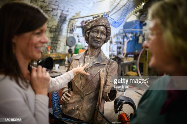 Alexis Bowater , the woman behind a campaign to erect a statue of Nancy Astor, the first female MP, reacts after seeing the torso of the casting for...