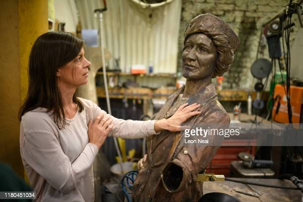 Alexis Bowater, the woman behind a campaign to erect a statue of Nancy Astor, the first female MP, reacts after seeing the torso of the casting for...