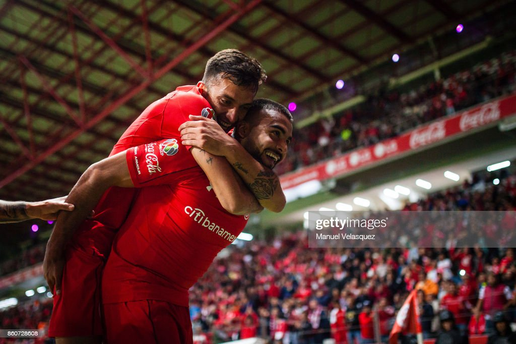 Alexis Canelo of Toluca celebrates with teammate Maximiliano Perg of Toluca after scoring the first goal of his team during the 13th round match between Toluca and Lobos BUAP as part of the Torneo Apertura 2017 Liga MX at Nemesio Diez Stadium on October 11, 2017 in Toluca, Mexico.
