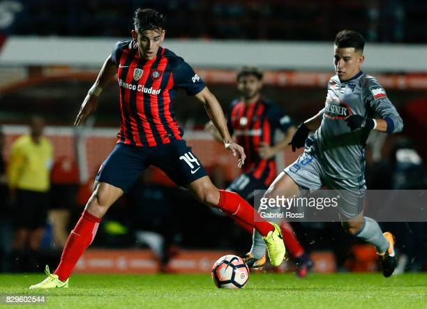Alexis Castro of San Lorenzo fights for the ball with Fernando Gaibor of Emelec during a second leg match between San Lorenzo and Emelec as part of...