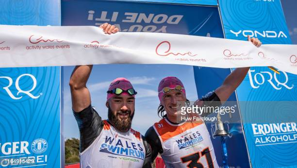 Alexis Charrier and Nicolas Remires Celebrate winning the Wales SwimRun race through Pembrokeshire starting in Freshwater East finishing at Amroth on...