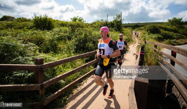 Alexis Charrier and Nicolas Remires lead the Wales SwimRun race through Pembrokeshirestarting in Freshwater East finishing at Amroth on July 27 2019...