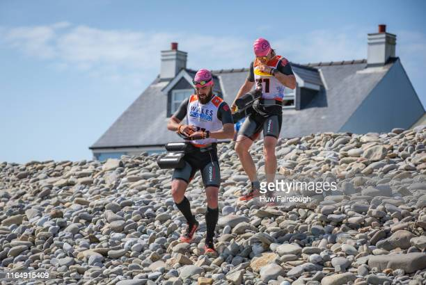 Alexis Charrier and Nicolas Remires prepare to enter the sea for their final swim during the Wales SwimRun race through Pembrokeshire starting in...
