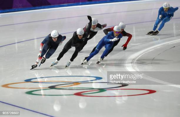 Alexis Contin of France Reyon Kay of New Zealand and SeungHoon Lee of Korea compete during the Men's Speed Skating Mass Start Semifinal 1 on day 15...