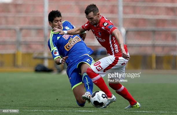 Alexis Cossio of Sporting Cristal struggles for the ball with Hector Icart of Cienciano during a match between Cienciano and Sporting Cristal as part...