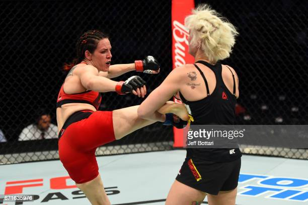 Alexis Davis kicks Cindy Dandois of Belgium in their women's bantamweight bout during the UFC Fight Night event at Bridgestone Arena on April 22 2017...