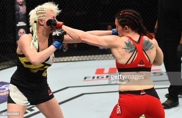 Alexis Davis of the Canada and Cindy Dandois of Belgium trade punches in their women's bantamweight bout during the UFC Fight Night event at...