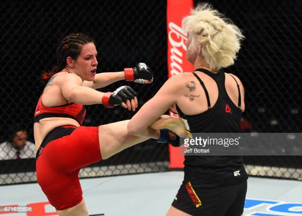 Alexis Davis of the Canada kicks Cindy Dandois of Belgium in their women's bantamweight bout during the UFC Fight Night event at Bridgestone Arena on...