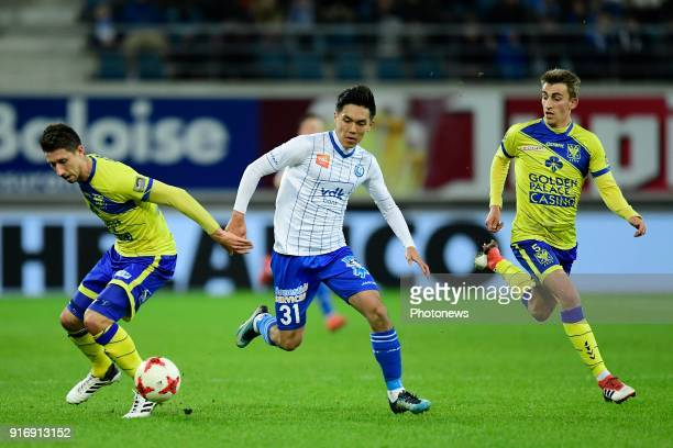 Alexis De Sart midfielder of STVV and Sasha Kotysch defender of STVV are challenged by Yuya Kubo forward of KAA Gent during the Jupiler Pro League...