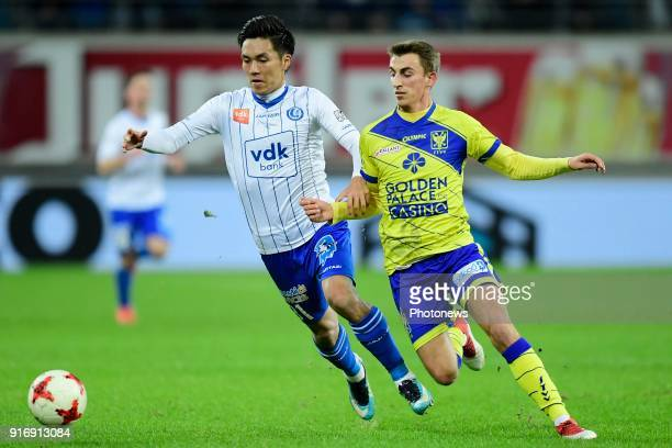 Alexis De Sart midfielder of STVV is challenged by Yuya Kubo forward of KAA Gent during the Jupiler Pro League match between KAA Gent and Sint...
