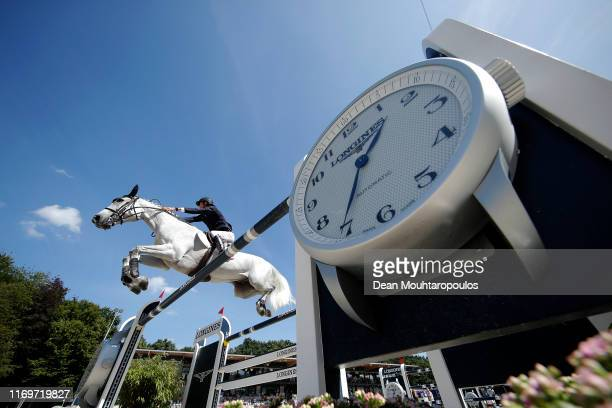 Alexis Deroubaix of France riding Timon d'Aure competes during Day 4 of the Longines FEI Jumping European Championship 2nd part, team Jumping 1st...
