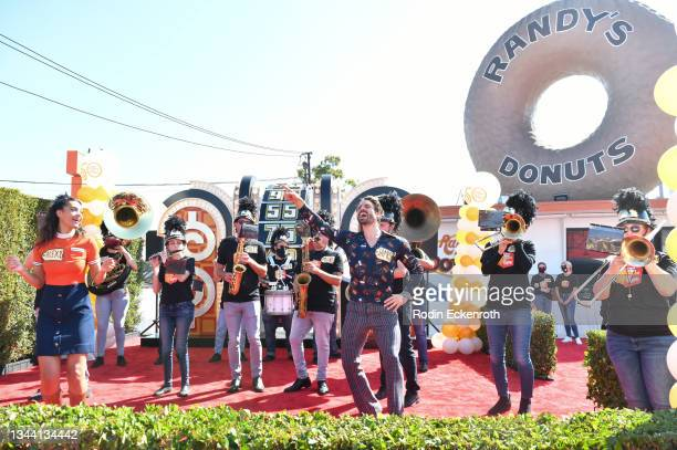 """Alexis Gaube and James O'Halloran dance along with marching band in the Showcase Showdown at CBS """"The Price Is Right"""" 50th Season Celebration at..."""