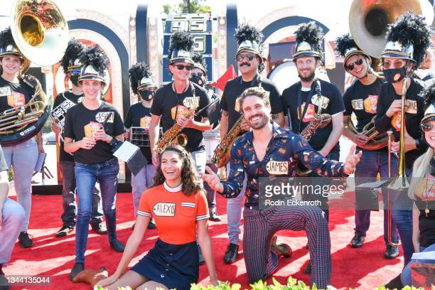 """Alexis Gaube and James O'Halloran pose for portrait with marching band in the Showcase Showdown at CBS """"The Price Is Right"""" 50th Season Celebration..."""