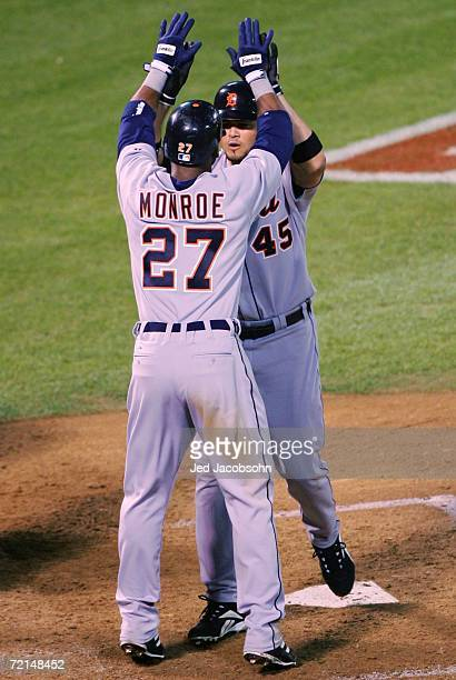 Alexis Gomez is congratulated by Craig Monroe of the Detroit Tigers after hitting a two run home run during the sixth inning of Game Two of the...