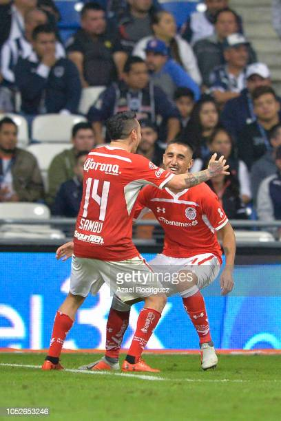 Alexis Gonzalez of Toluca celebrates with teammate Rubens Sambueza after scoring his team's first goal during the 13th round match between Monterrey...