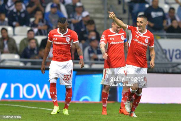 Alexis Gonzalez of Toluca celebrates with teammates after scoring his team's first goal during the 13th round match between Monterrey and Toluca as...