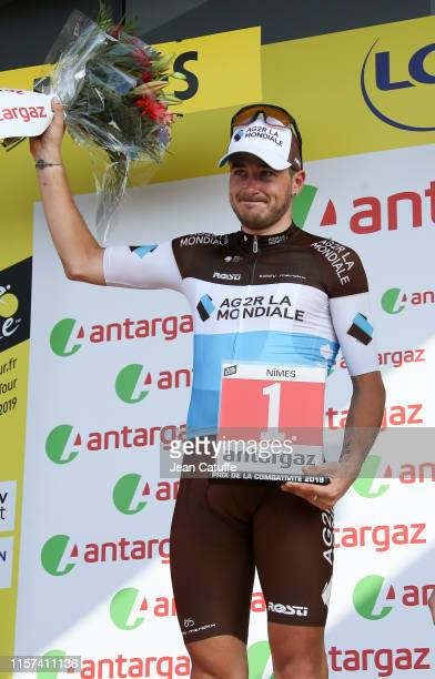 Alexis Gougeard of France and AG2R receives the trophy for best combative rider of the day during the podium ceremony following stage 16 of the 106th...