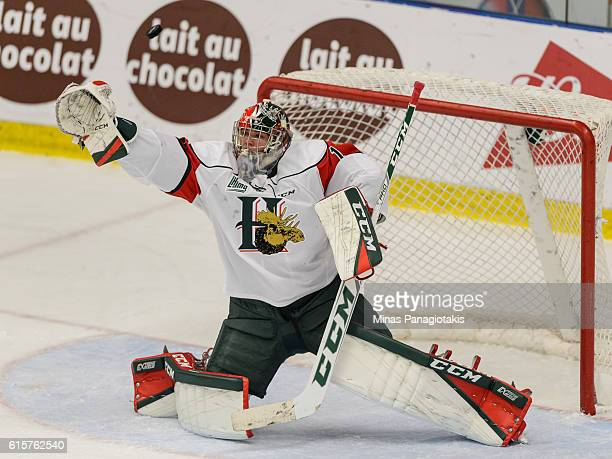 Alexis Gravel of the Halifax Mooseheads reaches for the puck during the QMJHL game against the BlainvilleBoisbriand Armada at the Centre d'Excellence...