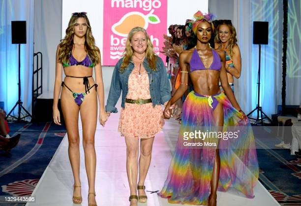 Alexis Gray and designer Lainey Gold walk the runway for Mango Beach Swimwear during Orlando Swim Week Powered By hiTechMODA on July 18, 2021 in...