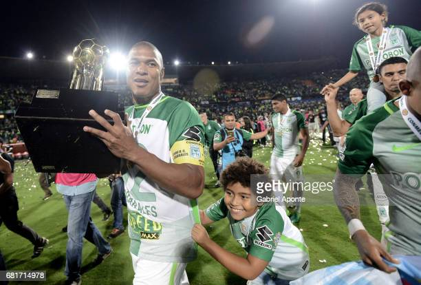 Alexis Henriquez of Nacional celebrates with the trophy after winning a match between Atletico Nacional and Chapecoense as part of CONMEBOL Recopa...
